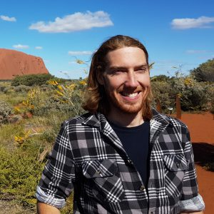 Cody in front of the Uluru in Australia