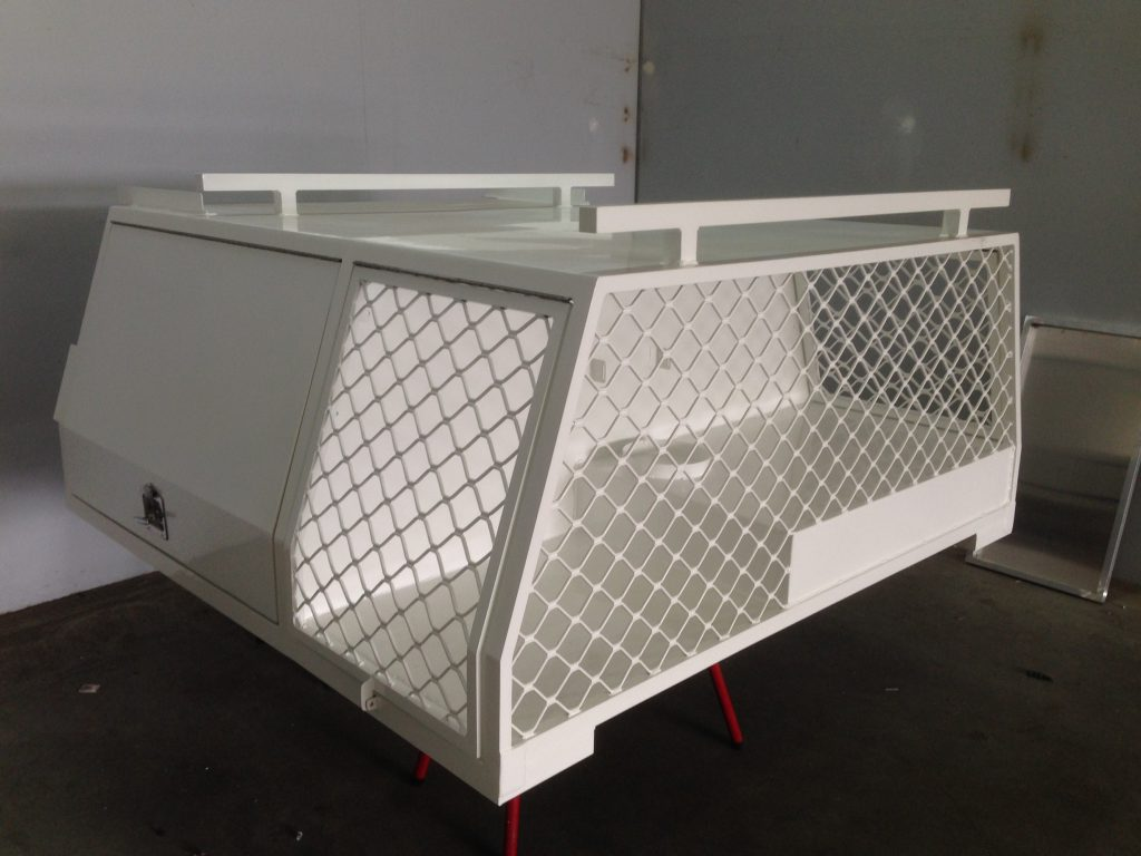 White powder coated camper box with the doors attached.